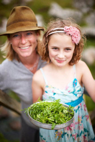 Photograph of Caroline Davey from Fat Hen, the Wild Cookery School in Cornwall with her daughter Ella.