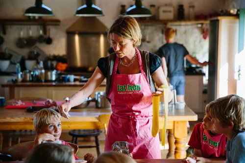 Photograph of Caroline Davey from Fat Hen, teaching a children's cookery class