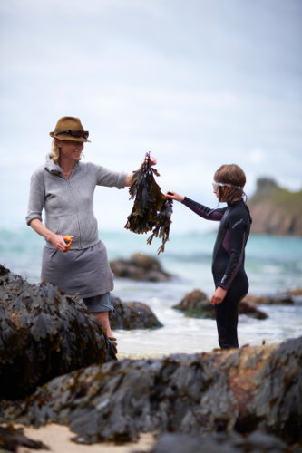 Photograph of Caroline Davey from Fat Hen, The Wild Cookery School on the beach in Cornwall.