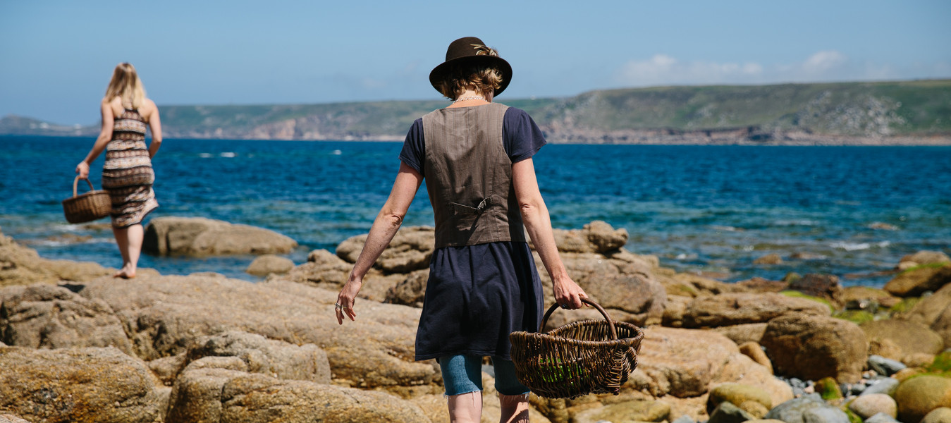 Photograph of Caroline Davey from Fat Hen foraging for wild food in Cornwall