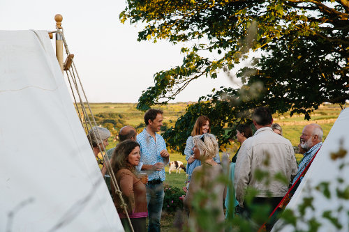 Photograph of a group drinking aperitifs prior to a wild dining event at Fat Hen, the Wild Cookery School
