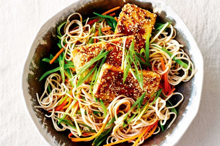 Sesame crusted tofu with noodles, seaweed and sea beet
